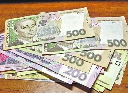 Украинцы чаще стали нести гривну на депозиты