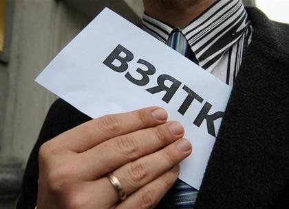 На Харьковщине полицейского подозревают в получении взятки